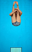 Japanese diver Ken Terauchi performs an inward 2 1/2 somersault in the men's 3m springboard semifinal at the XXIX Olympic Summer Games at the National Stadium in Beijing, China.
