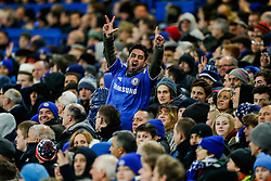 A Chelsea supporter taunts the Sporting away fans with the matches 3-1 scoreline shown with his hands - Photo mandatory by-line: Rogan Thomson/JMP - 07966 386802 - 10/12/2014 - SPORT - FOOTBALL - London, England - Stamford Bridge - Sporting Clube de Portugal - UEFA Champions League Group G.