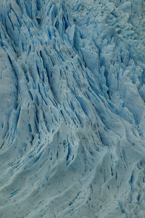 Crevasses are seen on the surface of a glacier at Gran Campo Nevado, Jan. 24, 2004. Daniel Beltra/Greenpeace.