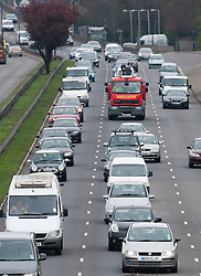 © London News Pictures. 05/04/2012. London, UK.  Heavy traffic heading west bound on the A40 leaving London on April 5, 2012 for the great East getaway.  Drivers face high prices to fill up their tanks as the price of fuel hits a record high. Photo credit :  Ben Cawthra/LNP