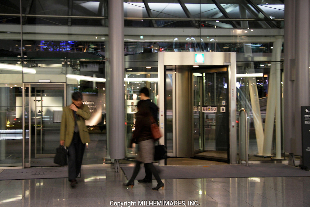 Workers commute to and from Shiodome Media Center, Tokyo Japan 2008.