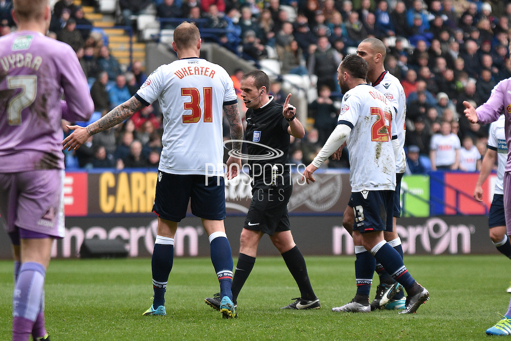 Bolton Wanderers Defender, David Wheater disagrees with Referee Mr Geoff Eltringham during the Sky Bet Championship match between Bolton Wanderers and Reading at the Macron Stadium, Bolton, England on 2 April 2016. Photo by Mark Pollitt.