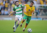 Yeovil - Tuesday, August 11th, 2009: Andrew Walsh of Yeovil and Simon Whaley of Norwich City during the Carling Cup 1st Round match at Yeovil. (Pic by Alex Broadway/Focus Images)
