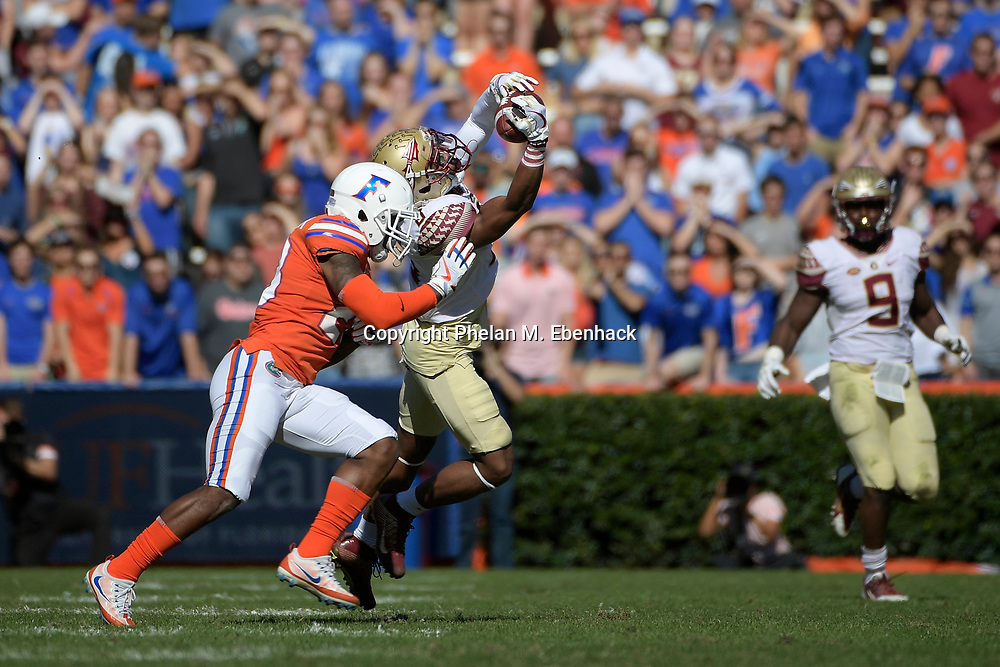 Florida defensive back Chauncey Gardner Jr. (23) breaks up a pass intended for Florida State wide receiver Nyqwan Murray (8) during the first half of an NCAA college football game Saturday, Nov. 25, 2017, in Gainesville, Fla. (Photo by Phelan M. Ebenhack)