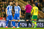 Brighton & Hove Albion full back Bruno Saltor (Captain) (2) has words with tonights referee Tim Robinson  during the EFL Sky Bet Championship match between Norwich City and Brighton and Hove Albion at Carrow Road, Norwich, England on 21 April 2017. Photo by Simon Davies.