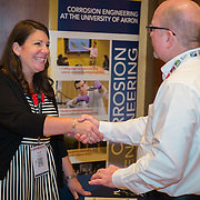 Annie Hanson from the University of Akron welcomes a NACE member at the BP Career Fair in San Antonio, TX. Photography by Dallas event photographer William Morton of Morton Visuals event photography.