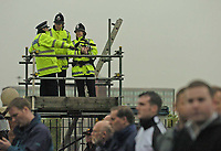 Photo. Jed Wee.<br /> Manchester United v Charlton Atheltic, FA Barclaycard Premiership, 20/04/2004.<br /> Security fears amidst terrorism raids in Manchester sees stepped up security at Old Trafford, as police survey the crowd from a high vantage point.
