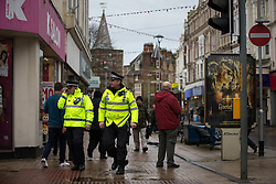 © Licensed to London News Pictures . 30/01/2016 . Dover , UK . Police on Biggin Street in Dover town centre , ahead of demonstrations by far-right groups (including The National Front , The North West Infidels and The South East Alliance ) and , opposing them , anti-fascists , close to the port of Dover in Kent . Photo credit : Joel Goodman/LNP