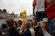 Tour de France Paris. 2005. Last corner for the finish. Public is entertained with funny advertisement before the cyclists arrive.