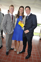 Left to right, BEN ALUN-JONES, LOUISA WENTWORTH-STANLEY and TOM ALUN-JONES at the 3rd day of the 2012 Glorious Goodwood racing festival at Goodwood Racecourse, West Sussex on 2nd August 2012.