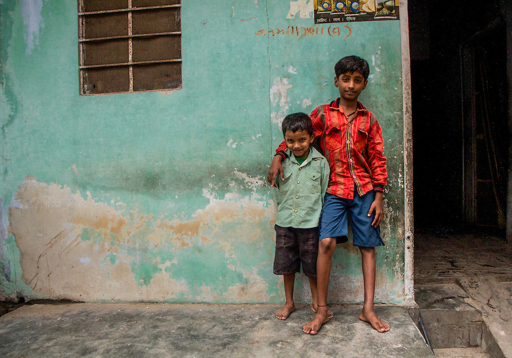 Two brothers stop playing in the streets of Jaipur to pose in front of the camera.