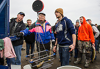 Max DesMarais of Gilford checks in a 5.15 lb Lake Trout at Derby Headquarters to earn a third place finish in the Great Meredith Rotary Ice Fishing Derby at Sunday afternoons award ceremony.   (Karen Bobotas/for the Laconia Daily Sun)