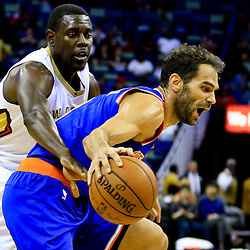 Mar 28, 2016; New Orleans, LA, USA; New Orleans Pelicans guard Jrue Holiday (11) defends New York Knicks guard Jose Calderon (3) during the first quarter of a game at the Smoothie King Center. Mandatory Credit: Derick E. Hingle-USA TODAY Sports