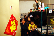 Chinese petitioners start their day in the cramp quarters they share, as they prepare head out to air grievances in hopes to have her case seen by the petitions office in  Beijing, China, Tuesday, March 3, 2009. Many Chinese have come from around the country to Beijing seeking redress for problems with local officials, flocking to the capital to coincide with the annual National People's Congress session. Their numbers commonly increase ahead of the meeting, and they are often followed by local police to the capital and taken back home.