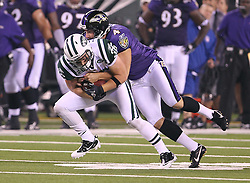 Sept 13, 2011; East Rutherford, NJ, USA; New York Jets safety Jim Leonhard (36) is tackled by Baltimore Ravens punter Sam Koch (4) during the first half at the New Meadowlands Stadium.