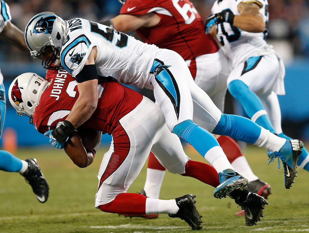 CHARLOTTE, NC - JAN 24:  Linebacker Luke Kuechly #59 of the Carolina Panthers tackles running back David Johnson #31 of the Arizona Cardinals during the NFC Championship game at Bank of America Stadium on January 24, 2016 in Charlotte, North Carolina.