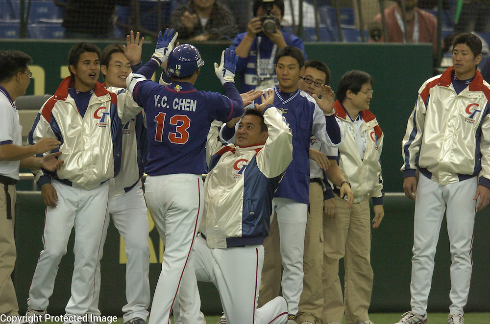 Team Chinese Taipei's Yung-Chi Chen is congratulated after hitting a grand slam in the 4th inning in Game 5 of the World Baseball Classic at Tokyo Dome, Tokyo, Japan.