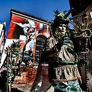 Masked revellers strolls in Venice  during the 2010 Venetian Carnival in Venice.