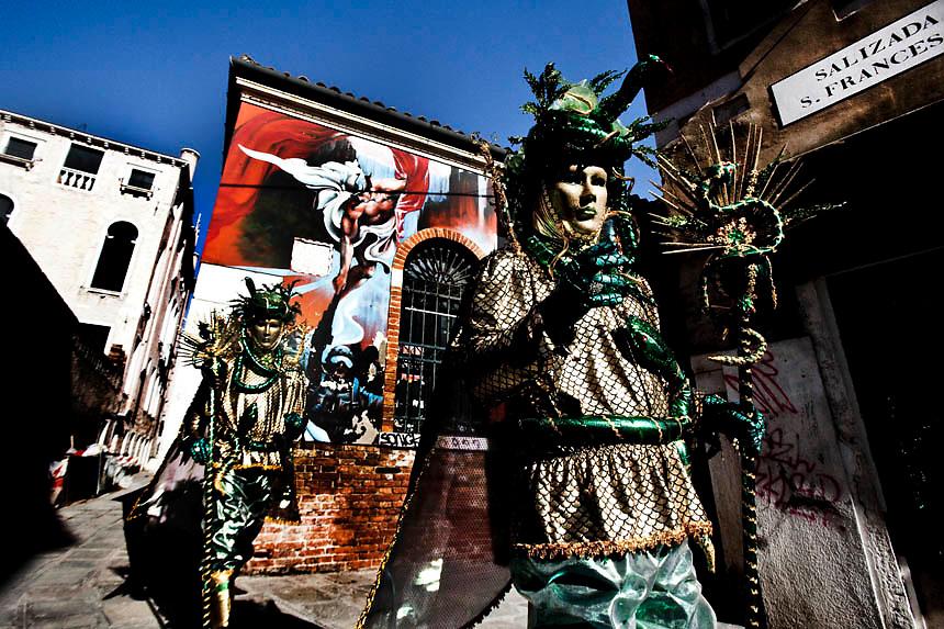 Masked revellers strolls in Venice  during the 2010 Venetian Carnival in Venice.