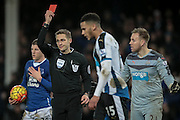 The referee shows Jamaal Lascelles (Newcastle United) a red card for his challenge on Ross Barkley (Everton) during the Barclays Premier League match between Everton and Newcastle United at Goodison Park, Liverpool, England on 3 February 2016. Photo by Mark P Doherty.