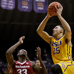 Jan 16, 2016; Baton Rouge, LA, USA; LSU Tigers forward Ben Simmons (25) shoots over Arkansas Razorbacks forward Moses Kingsley (33) during the second half of a game at the Pete Maravich Assembly Center. LSU defeated Arkansas 76-74. Mandatory Credit: Derick E. Hingle-USA TODAY Sports