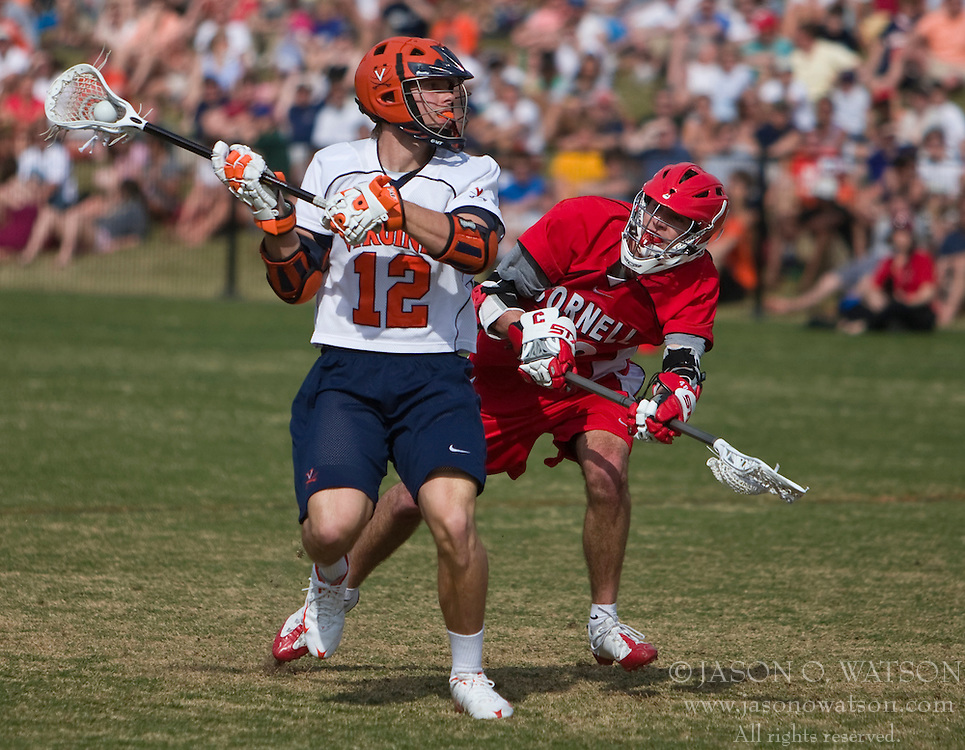 Virginia Cavaliers M/A John Haldy (12) prepares a shot past Cornell Big Red M Roy Lang (48).  The #1 ranked Virginia Cavaliers defeated the #4 ranked Cornell Big Red 14-10 at Klockner Stadium on the Grounds of the University of Virginia in Charlottesville, VA on March 8, 2009.