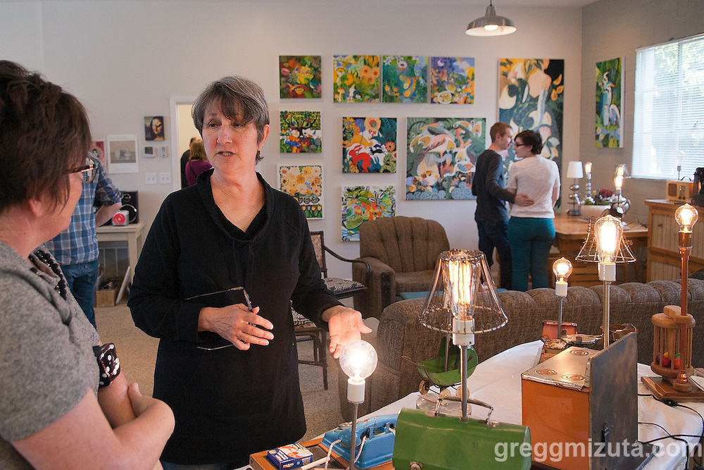 Artist Gina Phillips talks to Trish Mizuta about her handmade electric lamps made from eclectic repurposed, recycled, upcycled, reused, reimagined, and salvaged vintage lamps.<br /> <br /> Gina's shared studio w/Geoffery Krueger, Karen Woods, and Hindi Morland, was one of the venues on Jodi Eichelberger's ST(r)EAM Bike/Art tour through the Surel Mitchell Live-Work-Create District in Garden City, Idaho on April 30, 2016.<br /> <br /> Artists and venues on the tour included Surel's Place, Megan Levad, Sara Hill, Will Bennett, Victor Myers and Corridor Surf Shop, Geoffery Krueger, Karen Woods, Gina Phillips, Hindi Morland, Heidi Haislmaier and the new Telaya Winery where Segreto Wood Fired Pizza set up shop for the bike tour group.