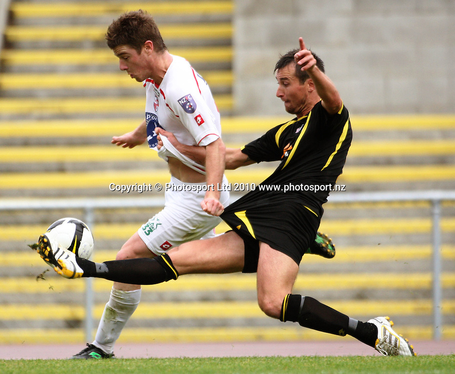 Wellington's Michael Winsauer (right) tackles Brent Fisher.<br /> NZFC soccer  - Team Wellington v Waitakere United at Newtown Park, Wellington. Sunday, 4 April 2010. Photo: Dave Lintott/PHOTOSPORT