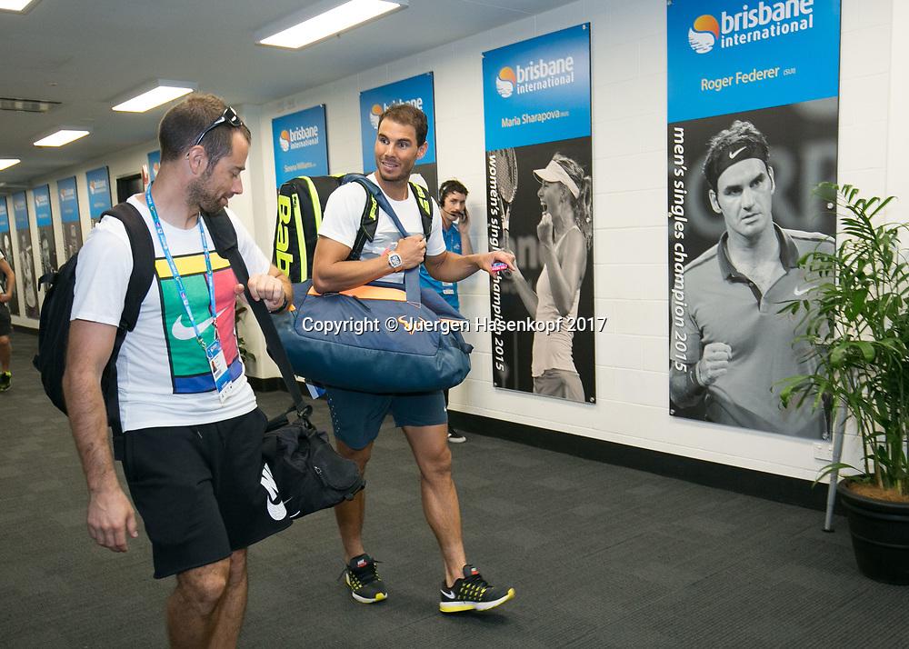 RAFAEL NADAL (ESP) und sein Trainingspartner gehen an einem Poster von Roger Federer vorbei,<br /> <br /> Tennis - Brisbane International  2017 - ATP -  Pat Rafter Arena - Brisbane - QLD - Australia  - 4 January 2017. <br /> &copy; Juergen Hasenkopf