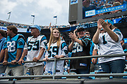 Panther fans cheering for their team in the New Orleans Saints 34 to 13 victory over the Carolina Panthers.