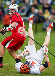 Maryland Terrapins Defense Mike Griswold (14) knocks Virginia Cavaliers LSM Mike Timms (44) to the turf.  The #9 ranked Maryland Terrapins fell to the #1 ranked Virginia Cavaliers 10 in 7 overtimes in Men's NCAA Lacrosse at Klockner Stadium on the Grounds of the University of Virginia in Charlottesville, VA on March 28, 2009.