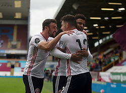 John Egan of Sheffield United (C) celebrates after scoring his sides first goal - Mandatory by-line: Jack Phillips/JMP - 05/07/2020 - FOOTBALL - Turf Moor - Burnley, England - Burnley v Sheffield United - English Premier League