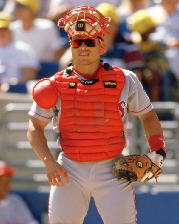 CHICAGO - 1998:  Ivan Rodriguez of the Texas Rangers looks on while catching during an MLB game versus the Chicago White Sox at Comiskey Park in Chicago, Illinois during the 1998 season. (Photo by Ron Vesely).  Subject:   Ivan Rodriguez