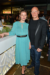 CAMILLA RUTHERFORD and DOMINIC BURNS at the Belvedere Balance Bar Launch Party at The Hoxton Hotel, 81 Great Eastern Street, London on 10th May 2016.
