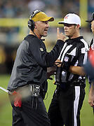 Jacksonville Jaguars head coach Gus Bradley yells at the officials as he makes a point with his index finger during the 2015 week 11 regular season NFL football game against the Tennessee Titans on Thursday, Nov. 19, 2015 in Jacksonville, Fla. The Jaguars won the game 19-13. (©Paul Anthony Spinelli)