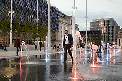 "© Licensed to London News Pictures. 05/07/2019. Birmingham, West Midlands UK. The hoardings were removed this week on the first phase of the £16m development of Centenary Square, Birmingham. A mirror lake was revealed with coloured fountains rising and falling in sporadic sequences. Already, only days after opening it has caused a Brummie ""Walking on Water"" craze as toddlers, children, cyclists, shoppers and City staff have taken to walking between the fountains on their way to the New Library of Birmingham and the ICC. Photo credit: Dave Warren/LNP"