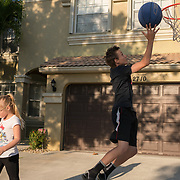 ROYAL PALM BEACH, FLORIDA, MARCH 15, 2017<br /> Tyler, 14, and Chloe Greaux, 8, shoot hoops in their driveway. Their mother Cynthia Greaux is able to use vouchers to pay for their enrollment at a private school that specializes in educating children with dyslexia.<br /> (Photo by Angel Valentin/Freelance)