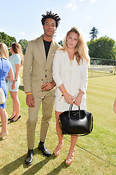 CHARLIE CASELY-HAYFORD and CHLOE HAYWARD at the Summer Solstice Party during the Boodles Tennis event hosted by Beulah London and Taylor Morris at Stoke Park, Park Road, Stoke Poges, Buckinghamshire on 21st June 2014.