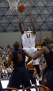 Dec 19, 2013; Long Beach, CA, USA; Long Beach State 49ers forward Daniel Samuels (11) is defended by Southern California Trojans forward Roschon Prince (2) at Walter Pyramid. Long Beach State defeated USC 72-71.