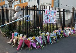 © Licensed to London News Pictures.  04/03/2015, Bristol, UK.  Flowers and tributes are left near Barton Court, after body parts were found yesterday in Barton Court, Barton Hill during the search for missing teenager Rebecca Watts aged 16 who disappeared from her home a mile away in Crown Hill in the St George area of Bristol on 19 February. Police carried out extensive searches across Bristol and today they charged Becky's stepbrother Nathan Matthews with her murder.  His girlfriend Shauna Hoare is charged with attempting to pervert the course of justice.  Five other people remain in custody on suspicion of assisting an offender.  Photo credit : Simon Chapman/LNP