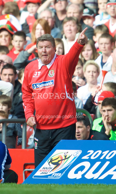 CARDIFF, WALES - Saturday, March 28, 2009: Wales' manager John Toshack MBE urges his side on during the 2010 FIFA World Cup Qualifying Group 4 match against Finland at the Millennium Stadium. (Pic by David Rawcliffe/Propaganda)
