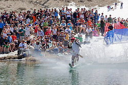 """""""Cushing Classic at Squaw Valley 3"""" - Photograph of a skier crossing a pond during the Cushing Classic at Squaw Valley, USA."""