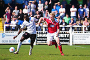 Wrexham Defender Oliver Marx challenges Bromley Forward Tobi Sho-Silva during the Vanarama National League match between Bromley FC and Wrexham FC at Hayes Lane, Bromley, United Kingdom on 8 April 2017. Photo by Jon Bromley.