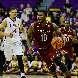 Feb 1, 2017; Baton Rouge, LA, USA; South Carolina Gamecocks guard Duane Notice (10) drives past LSU Tigers guard Skylar Mays (4) during the second half of a game at the Pete Maravich Assembly Center. South Carolina defeated LSU 88-63. Mandatory Credit: Derick E. Hingle-USA TODAY Sports
