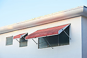 Metal awnings on a small Miami Modern apartment building in South Beach