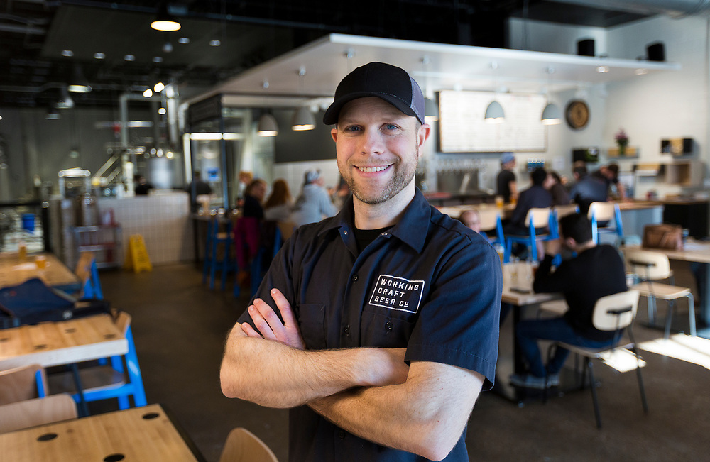 Working Draft Beer Company owner Ryan Browne poses for a portrait inside the taproom in Madison, Wisconsin, Thursday, March 22, 2018.