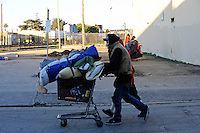 On Thursday, January 31st, Salinas city workers, health officials and police conducted an early morning sweep of the Chinatown homeless population, removing encampments on the street and in lots between buildings all along Soledad Street. Although ample warning had been given by authorities, a number of homeless were displaced and have now scattered across the city. A fencing company moved in right behind the city's workers, digging postholes, and erecting chain link fencing in sections. Using a front loader, unclaimed possessions were taken away and disposed of over the course of three hours, leaving many people standing about on the street with nowhere to go.