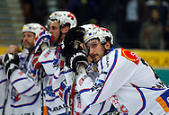 ZSC Lions defender Luca Camperchioli (R) and his teammates are disappointed after a 3-2 defeat during overtime in the ice hockey game five of the Swiss National League A Playoff Quarterfinal between Kloten Flyers and ZSC Lions held at the Kolping Arena in Kloten, Switzerland, Tuesday, March 8, 2011. (Photo by Patrick B. Kraemer / MAGICPBK)
