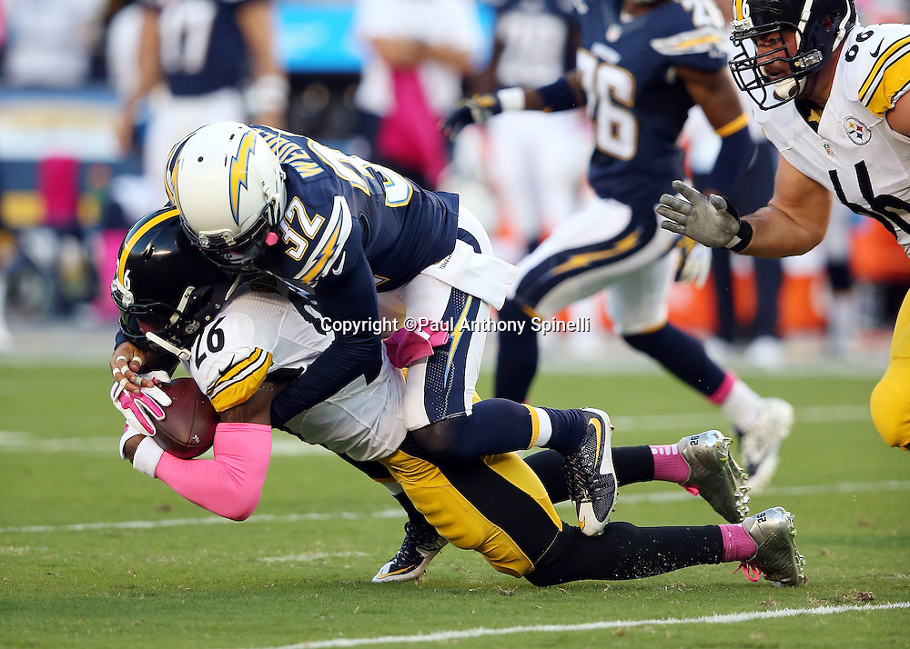 Pittsburgh Steelers running back Le'Veon Bell (26) carries San Diego Chargers free safety Eric Weddle (32) on his back while running for a first down on a third down play in the first quarter during the 2015 NFL week 5 regular season football game against the San Diego Chargers on Monday, Oct. 12, 2015 in San Diego. The Steelers won the game 24-20. (©Paul Anthony Spinelli)