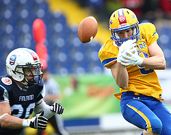 01.06.2014, NV Arena, St. Poelten, AUT, American Football Europameisterschaft 2014, Gruppe A, Finnland (FIN) vs Schweden (SWE), im Bild Juhani Koivumaki, (Team Finland, DB, #36) und  Fredrik Eklund, (Team Sweden, WR, #9) // during the American Football European Championship 2014 group A game between Finland and Sweden at the NV Arena, St. Poelten, Austria on 2014/06/01. EXPA Pictures © 2014, PhotoCredit: EXPA/ Thomas Haumer